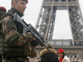 """French soldier patrol near the Eiffel Tower in Paris as part of the highest level of """"Vigipirate"""" security"""
