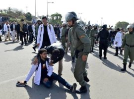 epa07383297 Moroccan public school teachers help a fellow wounded in scuffle with security forces as protesting teachers attempted to march towards the royal palace, in Rabat, Morocco, 20 February 2019. According to media reports, several Moroccan trade unions and civil groups called for protests and strikes on the 8th anniversary of the reform movement known as '20 February', which began in Morocco in 2011 inspired by the Arab Spring protests.  EPA/JALAL MORCHIDI