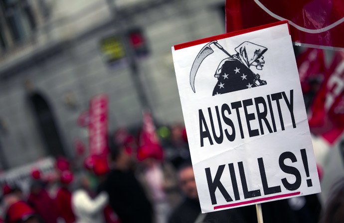 Placard held by a protester is seen during a demonstration against European and Spanish austerity measures in Madrid